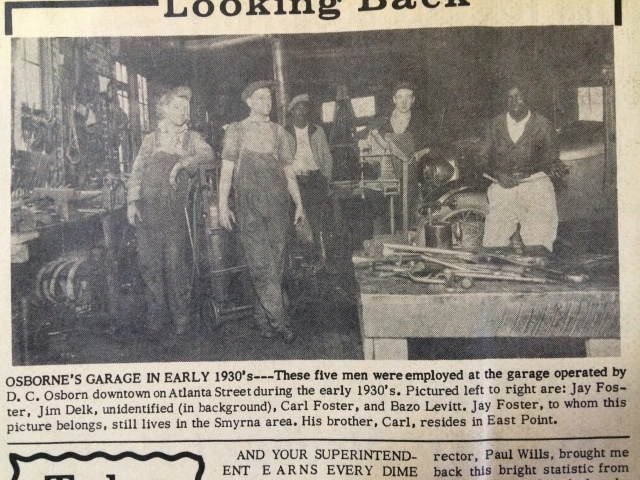 9. Osborne's Garage, interior view with workers, SH 11-15-62, p. 7-b