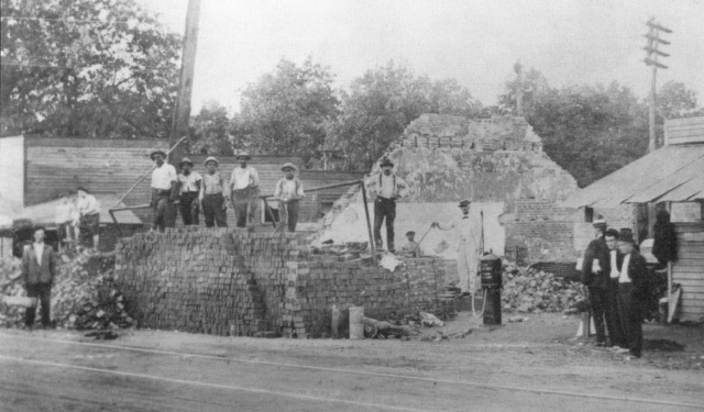 1ga. Cleanup on August 7, 1915 following a fire near the corner of Atlanta Road and East Spring StreetScan