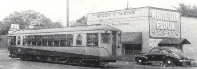 1gb. Black & Webb store with Streetcar at East Spring Street, 1946