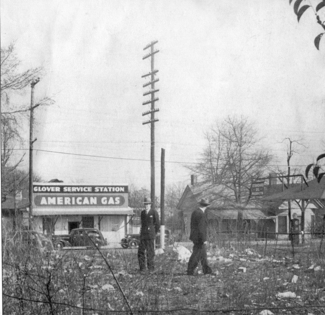 20. Henry Konigsmark and assocoate inspects trashy lot north of the Smyrna Memorial Cemetery for the Smyrna Men's Club, 1939
