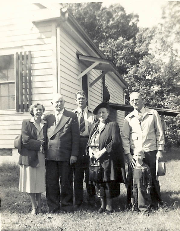 4. Terrell family at old farm house (Mary , John, Bob, Ted, Carl & Ricky, 1950)