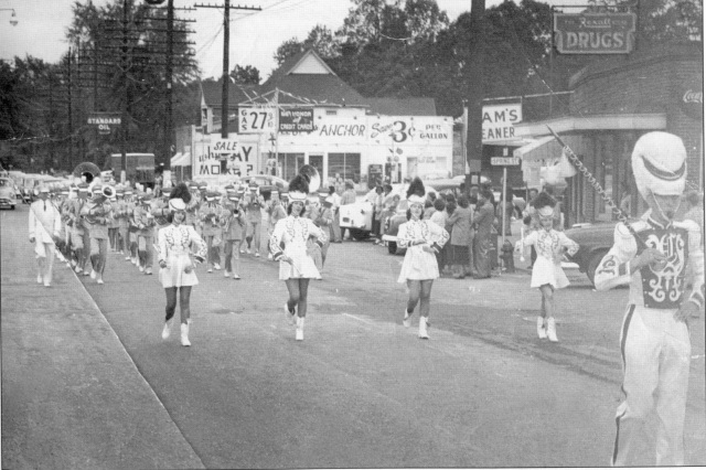 8. Campbell High School Marching Band, 1953, passing by corner of Atlanta Road and West Spring Street (current Market Village entryway)