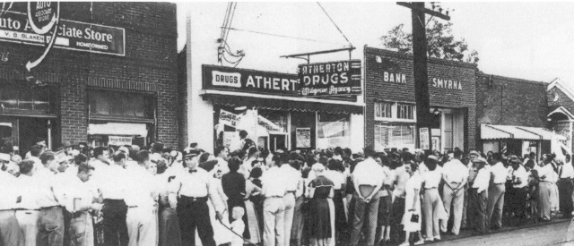 Crowd in front of Atherton Drug