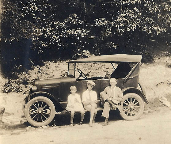 9. Helen, Robert, and Carl Terrell and atomobile about 1926