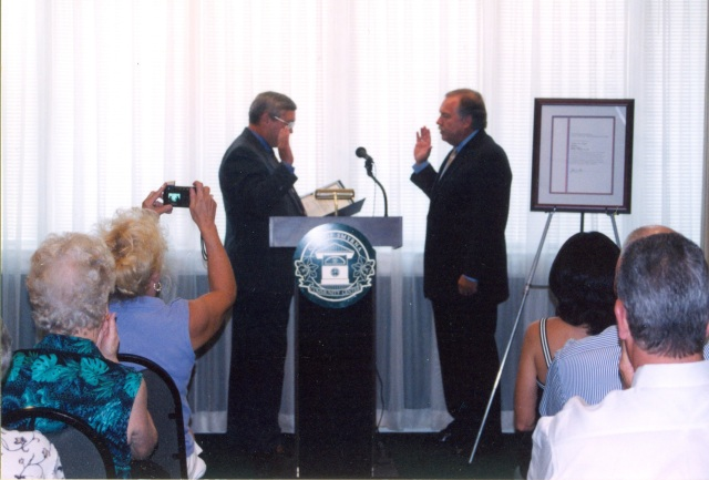 Joe Griggers swearing in Max Bacon as postmaster 2002