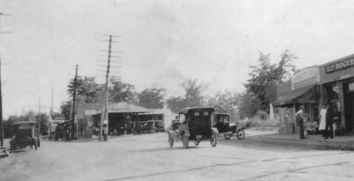 1b. Atlanta Road at Memorial Place in downtown Smyrna, with D.C. Osborne's Service Station in the foreground, c. 1915.jpeg